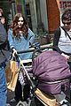 lily collins pushes stroller on love rosie set 01