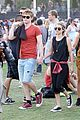 emma roberts and evan peters hold hands at coachella 201404