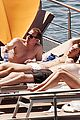 harry styles shirtless ponytail pool italy 29