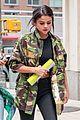 selena gomez covers up camo jacket 03