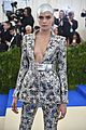cara covers her bald head with crystals at met08