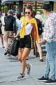 bella hadid rocks white bodysuit and yellow hoodie in nyc 03