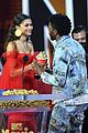zendaya presents chadwick boseman with best performance in a movie at mtv movie tv awards 01