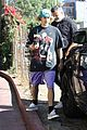 justin bieber poses with two dogs in a stroller before soccer game07