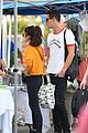 sarah hyland and wells adams share sweet kiss at the farmers market 08