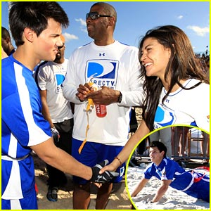 Taylor Lautner: Face To Sand Football Catch!