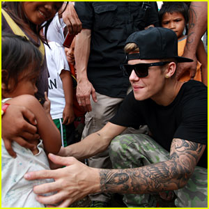 Justin Bieber Visits Typhoon Victims