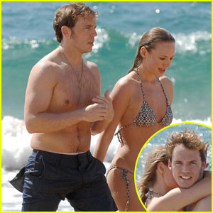 Shirtless Sam Claflin Frolics on Hawaiian Beach with Wife Laura Haddoc