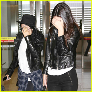 Kendall & Kylie Jenner Cover Faces Inside Airport After MMVAs