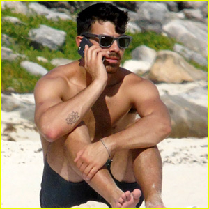Joe Jonas Sits in the Sand Shirtless While Taking a Phone Call in Cancun