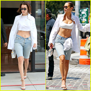 Bella Hadid Takes Off Her Shirt & Hangs It From Belt Hole in Jeans