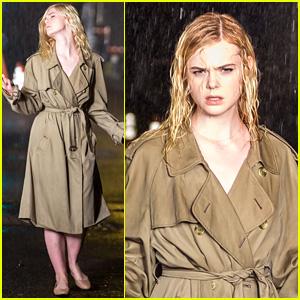 Elle Fanning Sports a Trench Coat in the Rain on Woody Allen Film Set