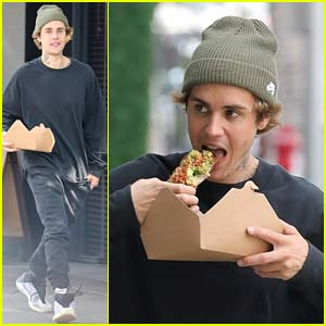 Justin Bieber Eats Avocado Toast While Walking Down the Sidewalk