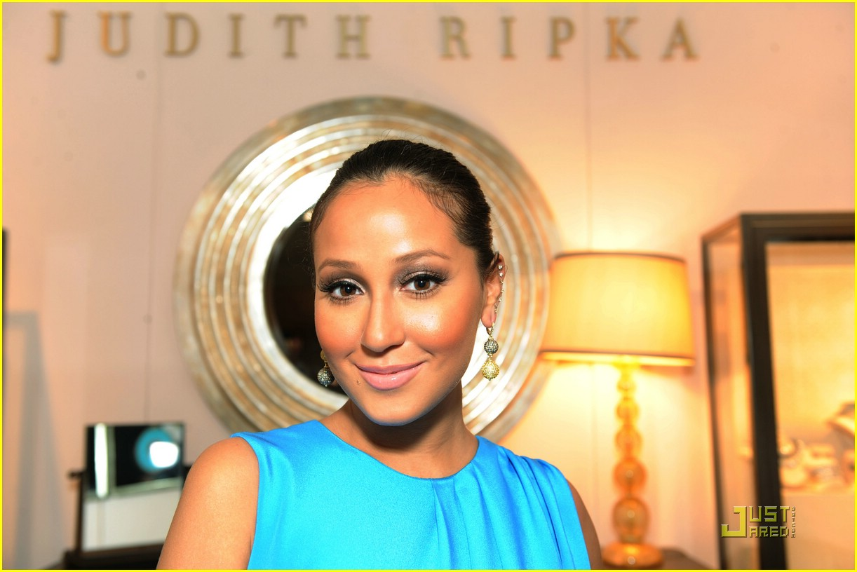About This Photo Set: Adrienne Bailon is a beauty in blue at the Spanx