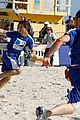 Lautner-football taylor lautner face sand football 01