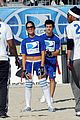 Lautner-football taylor lautner face sand football 26