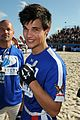 Lautner-football taylor lautner face sand football 30