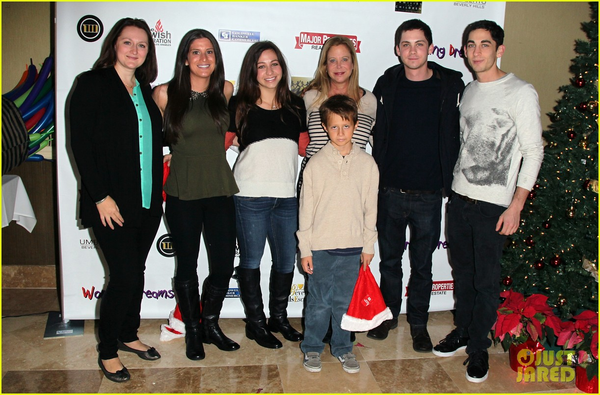 logan lerman working dreams toy drive 01