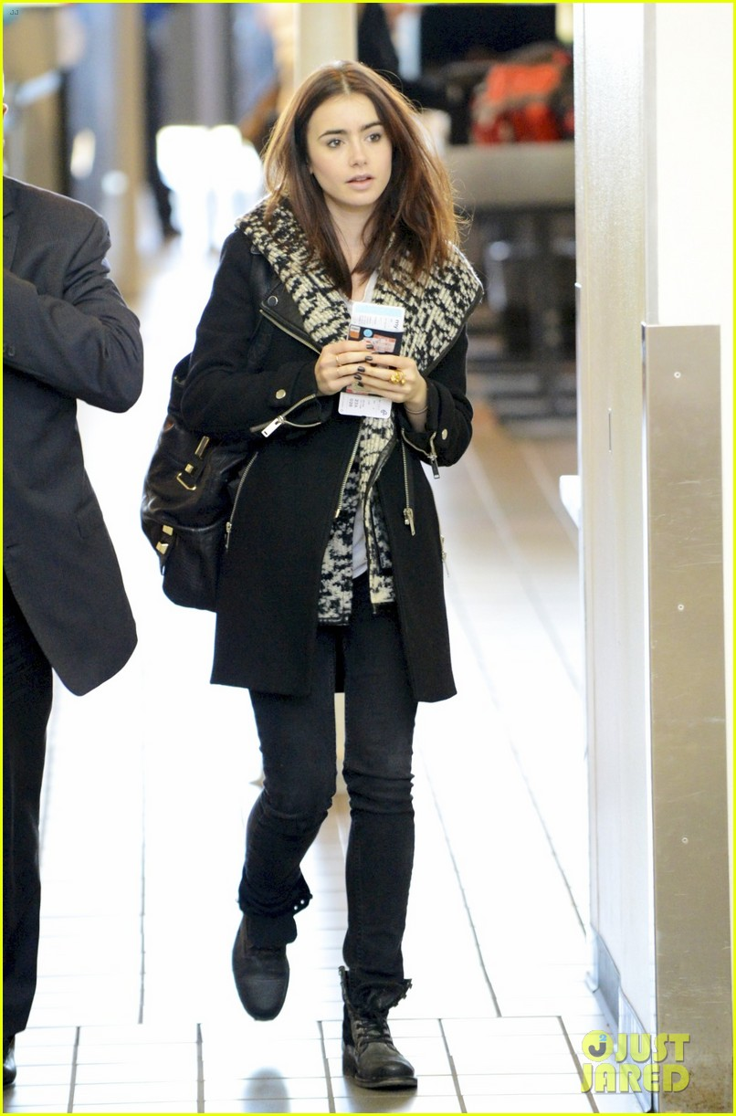 lily collins lax departure 01