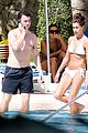 Joe-kevin-pool joe jonas kevin jonas girls poolside 02