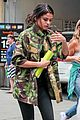 Sel-camo selena gomez covers up camo jacket 10