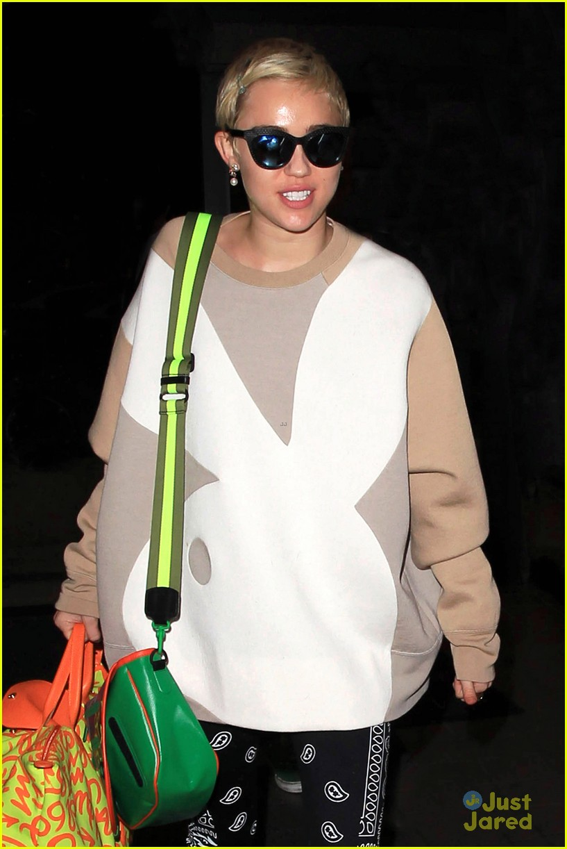 Full Sized Photo of miley cyrus playboy bunny at lax 02 | Miley Cyrus