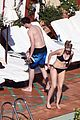 Hoult-shirt nicholas hoult shirtless by the pool 05