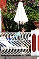 Hoult-shirt nicholas hoult shirtless by the pool 35