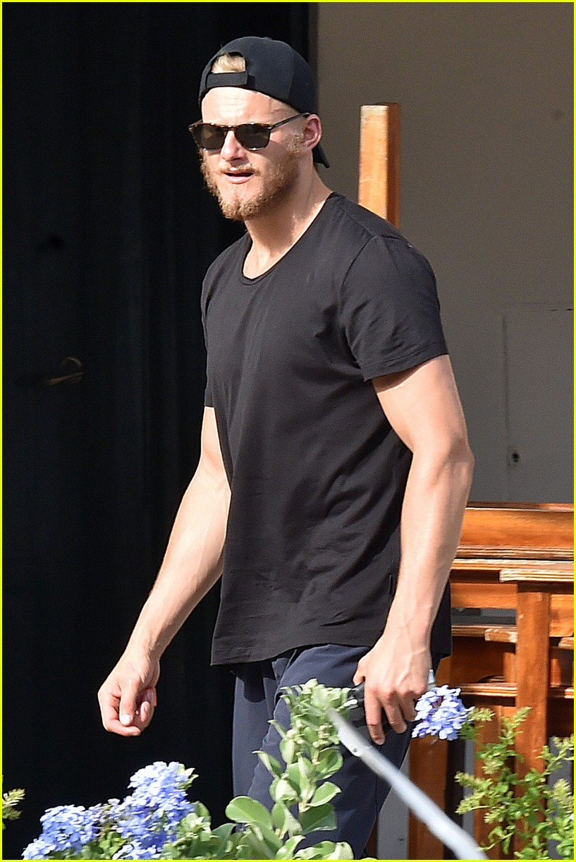 alexander ludwig goes shirtless while working out in italy 03