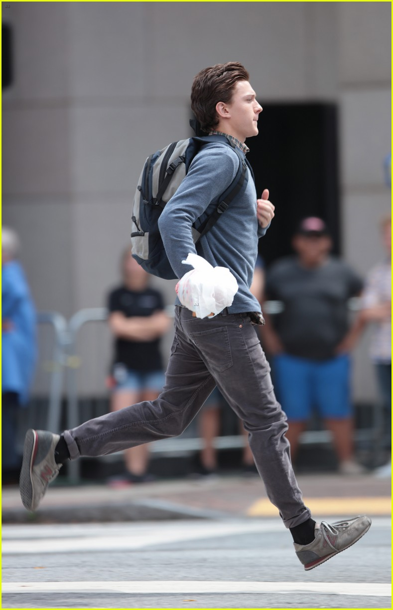 tom holland suits up on the set of spider man homecoming 12