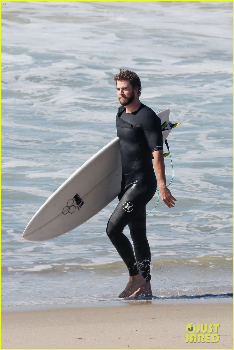 liam hemsworth goes for monday morning surf session with brother luke 01