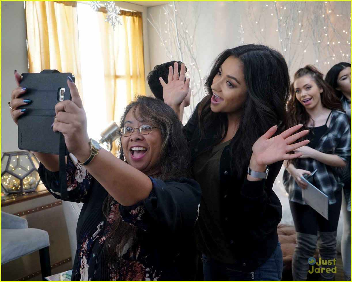 shay mitchell tahj mowry freeform stars pop up santa 03