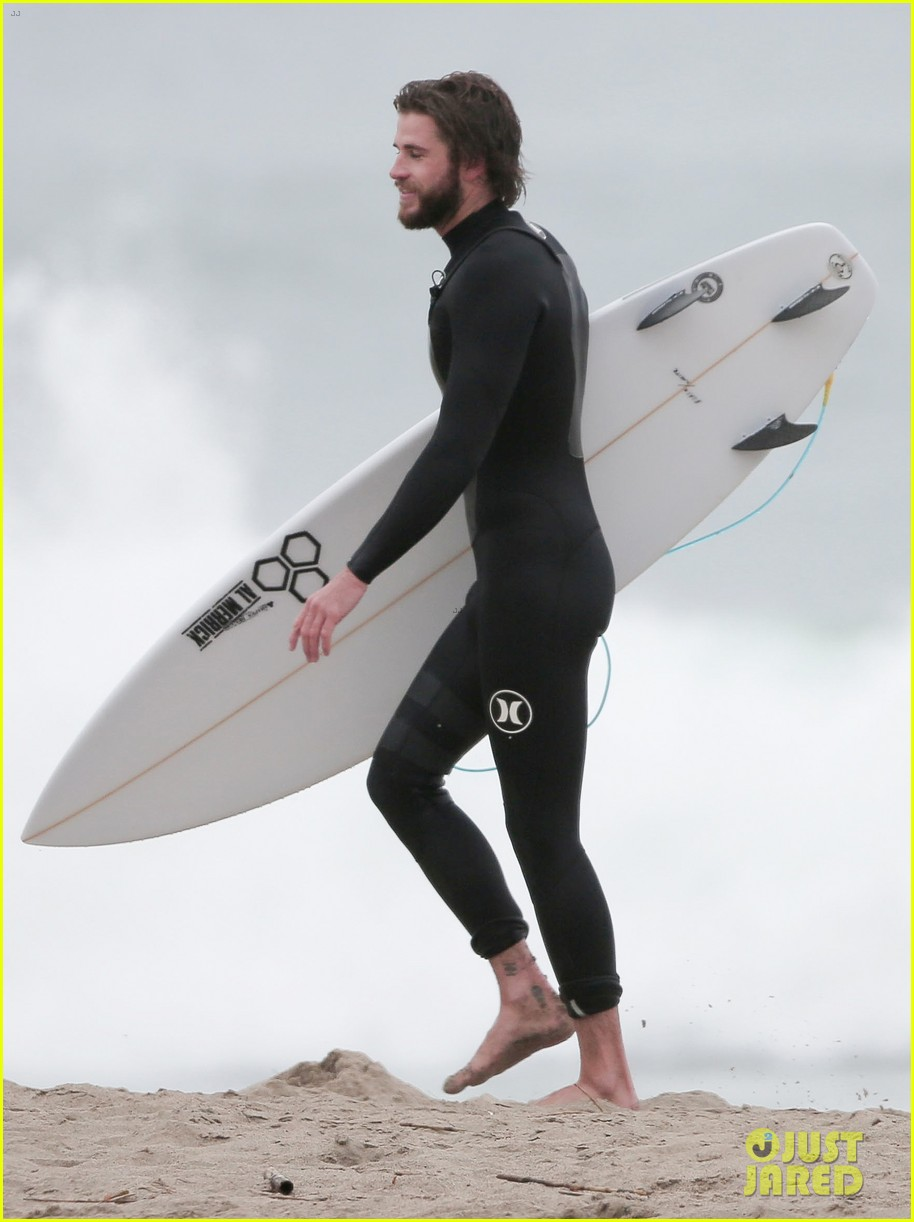 liam hemsworth hits the waves to kick off weekend 04