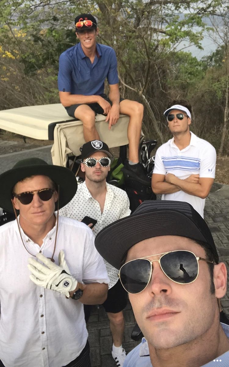 zac efron plays golf shirtless on vacation04