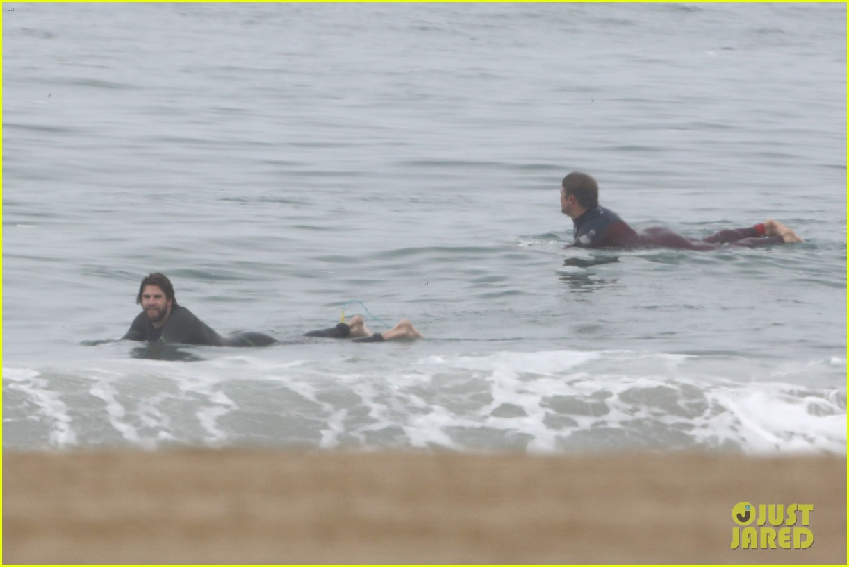 liam hemsworth strips out of wetsuit to reveal ripped abs 62