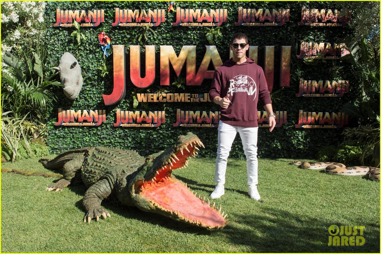 jack black nick jonas face off during jumanji promo 01